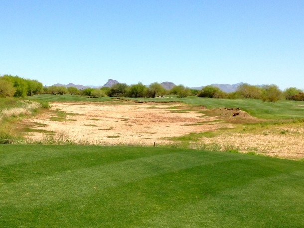 IMO - This is one of the best par 4s in the Valley of the Sun. Great risk/reward element with the waste area and boundary fence guarding the section of fairway short of the green, with a big bailout on short grass on the right.